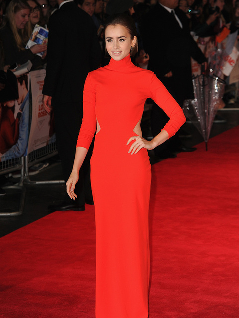 Lily Collins attends the Love, Rosie film premiere in London wearing Solace London, October 2014.