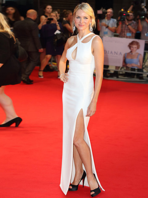 Naomi Watts stands out on the red carpet wearing a white dress by Versace to the