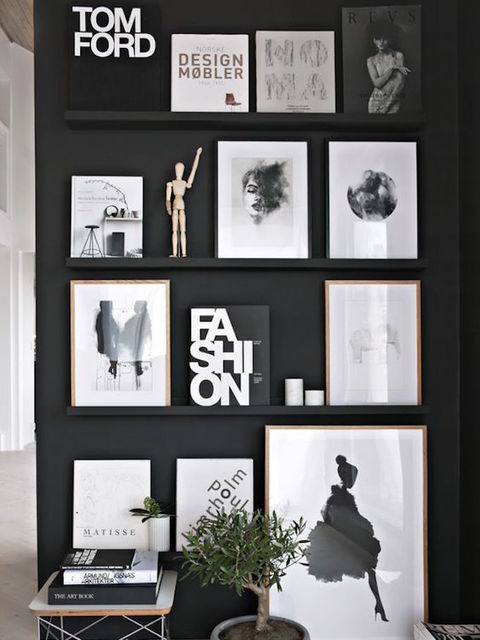 A simple black wall and a set of shallow floating