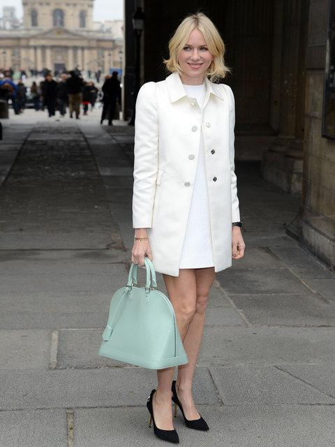 Naomi Watts attends the Louis Vuitton show during Paris Fashion Week wearing a sleek white dress