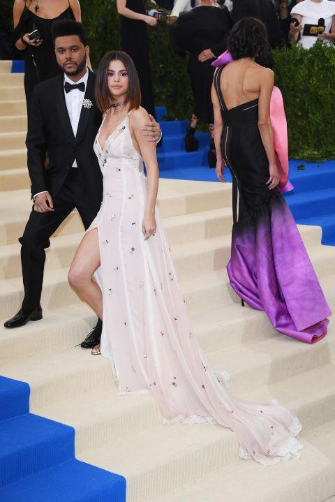 Selena is wearing a Coach dress