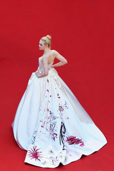 Elle Fanning attends the 'Ismael's Ghosts (Les Fantomes d'Ismael)' screening and Opening Gala during the Opening Ceremony of the 70th annual Cannes Film Festival at Palais des Festivals on May 17, 2017. The actress wears Vivienne Westwood's 'unicorn' dress.