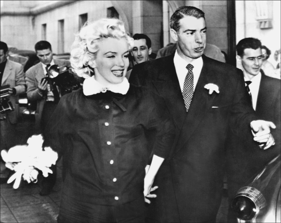 Monroe and Yankee star Joe DiMaggio pictured after marrying at city hall in San Francisco on January 14, 1954.