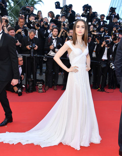 Lily Collins wore a white Ralph & Russo couture gown to attend the Cannes Film Festival, May 2017.