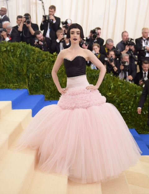 Lily Collins wore a pink tulle and black corseted Giambattista Valli gown to attend the 2017 Met Gala.