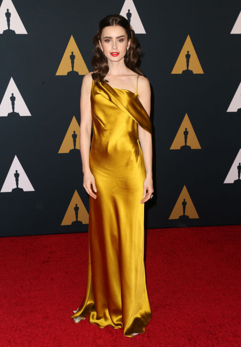 Lily Collins wore a yellow gold Amanda Wakeley dress to attend the 2016 Governor's Awards.