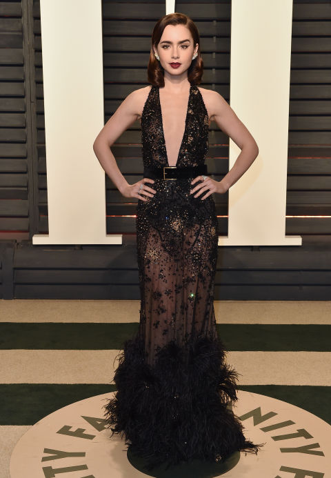 Lily Collins wore a black beaded Elie Saab Couture gown to the 2017 Vanity Fair Oscars party.