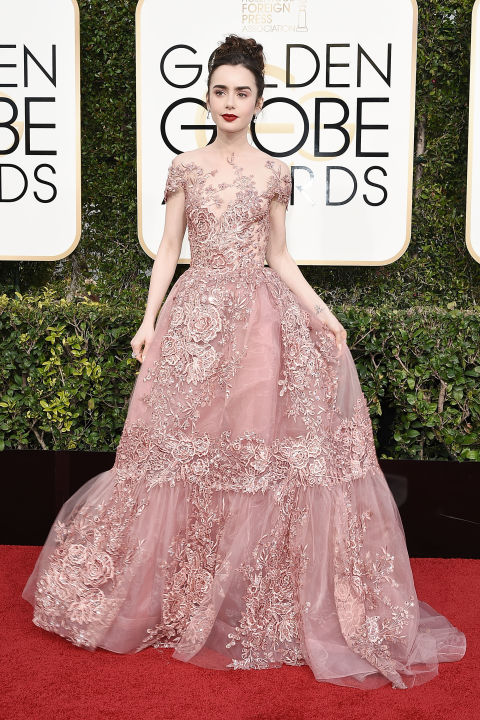 Lily Collins wore a pink lace Zuhair Murad gown to attend the 2017 Golden Globes.
